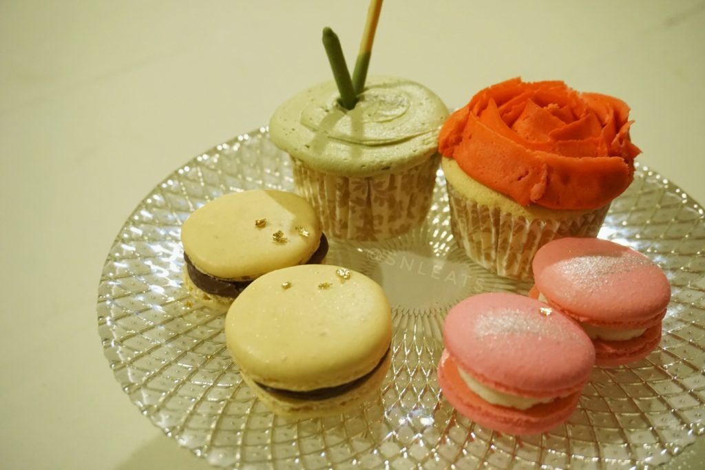 (left to right) Nutella macarons, Matcha fluffy cotton cupcake, cherry blossom fluffy cotton cupcake, cherry blossom macarons